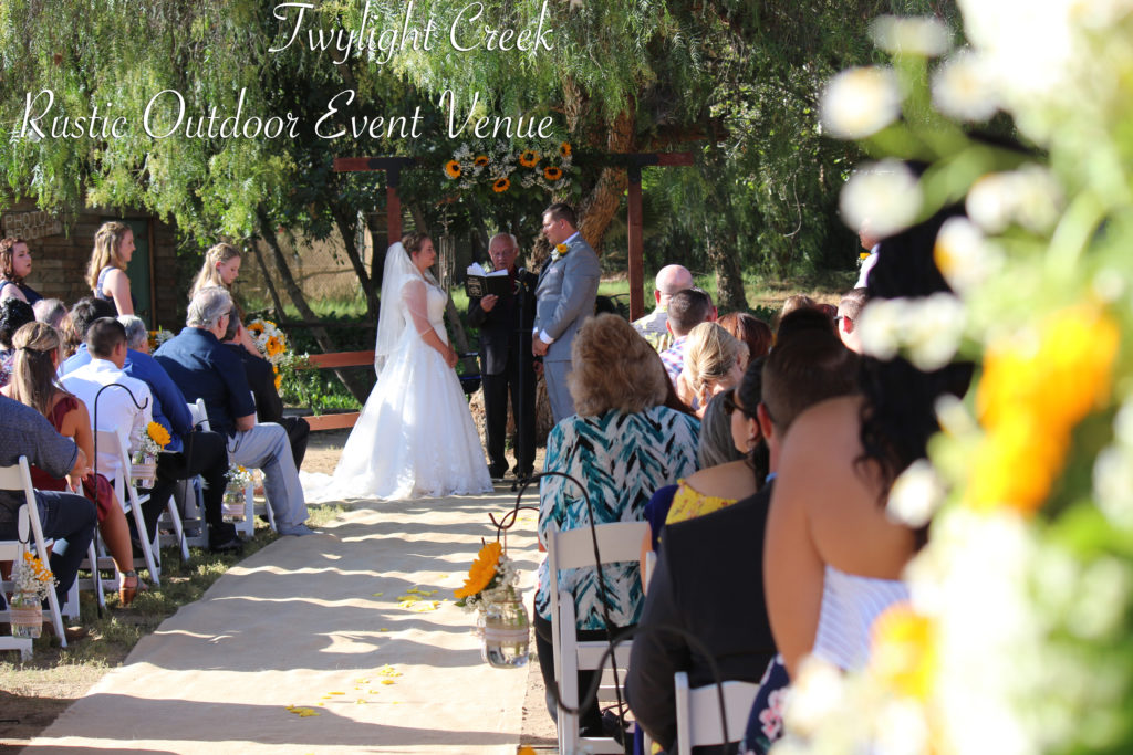 bride and groom getting married at outdoor venue